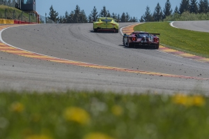 Aston Martin vs. Ford through Eau Rouge and Raidillon.